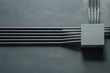 Box Of Transformer On Gray Wall