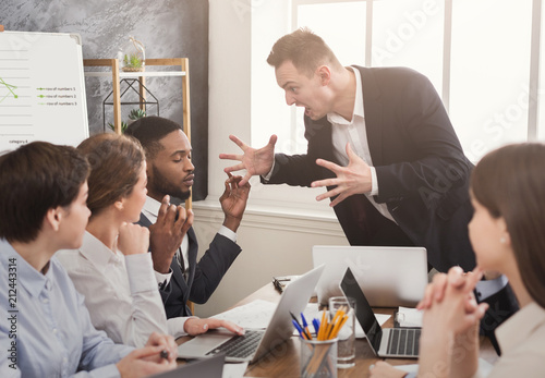 Fotografie, Obraz  Angry business man screaming at employee in office