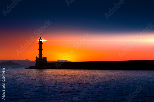 Foto op Canvas Kust A beautiful night sky behind a shining lighthouse. Chania, Crete, Greece