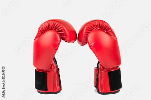 Fototapeta  Red leather boxing gloves isolated on white background