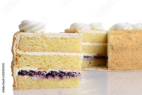 Cuadros en Lienzo closeup slice of blueberry cream cake with frosting