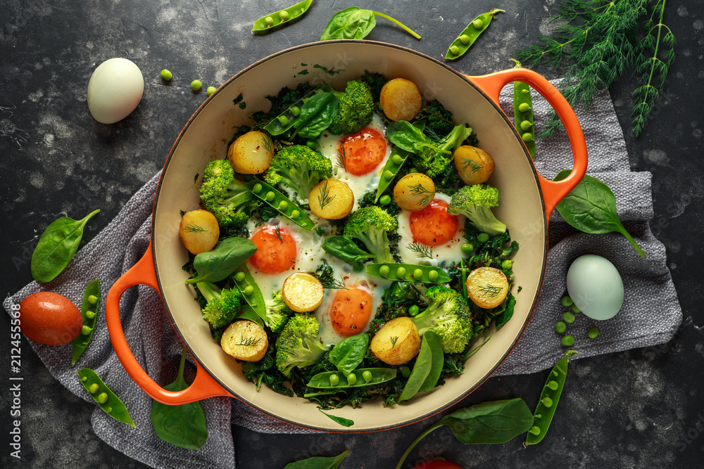 Fototapety, obrazy: One Pan Green shakshuka with kale, broccoli, sweet peas, spinach and dill with free range eggs, perfect supper.