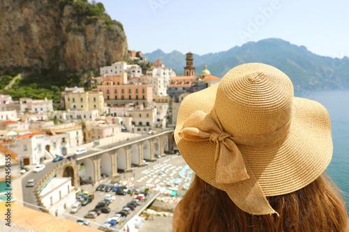 Fotografía  Woman with hat looking at typical italian landscape of Atrani village, Amalfi Co