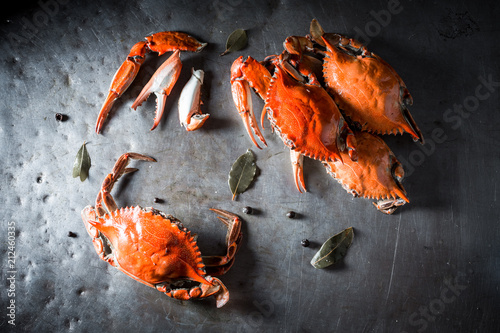Boiled crab with spices on old metal plate