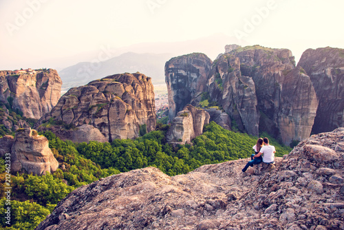 Photo  Loving couple makes a photo on a mobile phone in the mountains at sunset