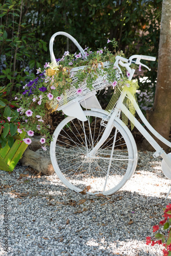 Foto op Canvas Fiets Bicycle decorated with flowers