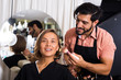 makeup artist applying cosmetics for female