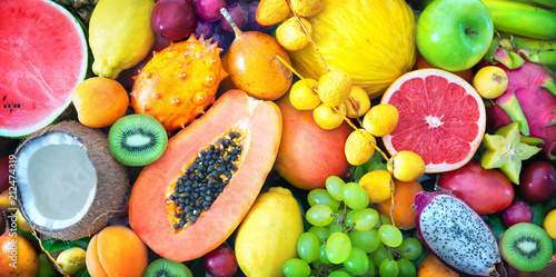 Poster Fruit Assortment of colorful ripe tropical fruits. Top view
