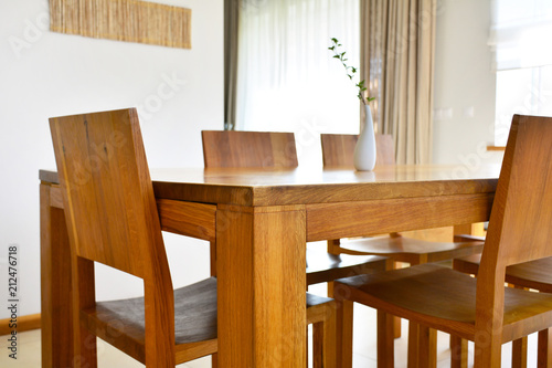 Obraz Natural oak wood dining table and chairs in neutral modern interior design house - fototapety do salonu