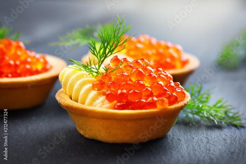 Salmon caviar. Tartlets with red caviar closeup. Gourmet food. Seafood. Trout caviar