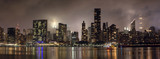 Fototapeta Nowy York - Manhattan skyline at night with reflections, NYC, USA.