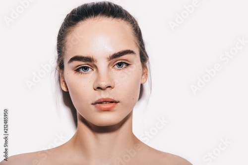 Beauty portrait of female model with perfect eyebrows with natural make up and healthy skin. Cosmetology and skin care concept