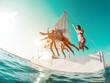 canvas print picture - Happy crazy friends diving from sailing boat into the sea