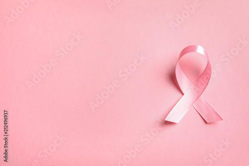 Pink ribbon on color background, top view. Cancer awareness Fototapet
