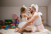 Little Daughter And Father Hav...