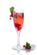 Red drink or cocktail in a glass for champagne isolated on white with red currant