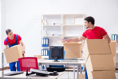 Fototapeta Two contractor employees moving personal belongings