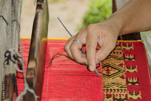 Hand of  master, production of a tapestry Fototapeta