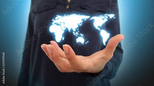 Fotografie, Obraz  Businesswoman holding world map hologram