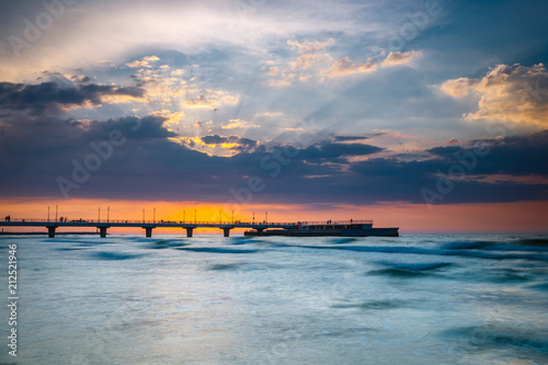 Canvas Prints Inspirational message Sunset on the beach with breakwater, long time exposure