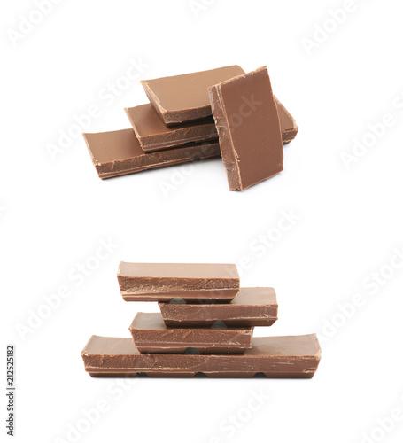 Aluminium Prints Grocery Pile of milk chocolate pieces isolated