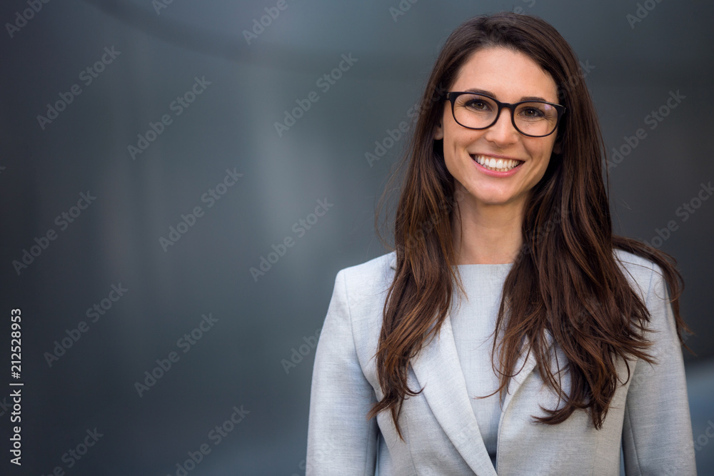 Fototapeta Smart, intelligent, friendly, likable portrait of an executive business woman manager, advisor, agent, representative with glasses