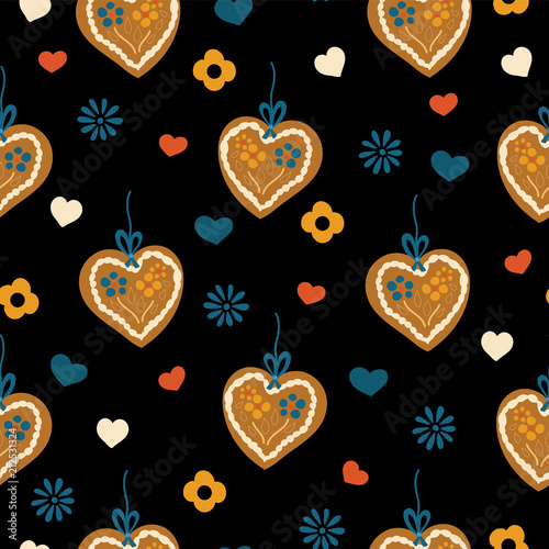 Fotografie, Obraz  Lebkuchenherz Gingerbread heart seamless pattern for Oktoberfest on a black background with blue, red, and white hearts and flowers