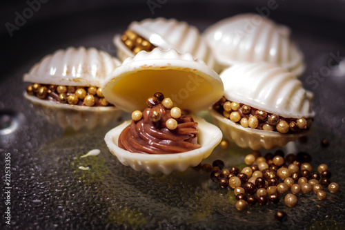 Vászonkép oyster-shaped candy made of chocolate, white chocolate (peel) and mini pearls of