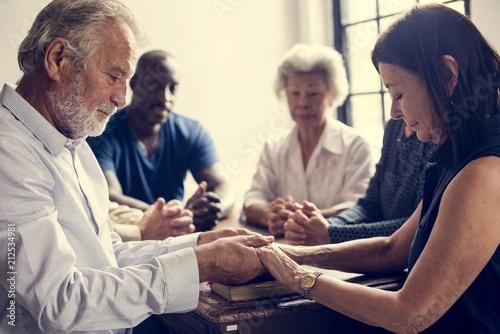 Foto op Aluminium Hoogte schaal Group of people holding hands praying worship believe