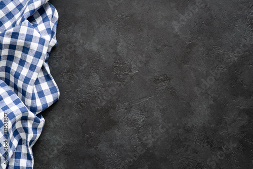 Black concrete background with blue checkered textile. Food background for recipe, cooking ingredients and restaurant design with copy space for text
