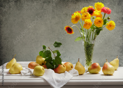 still life with bouquet of summer flowers in a jar and fresh pears