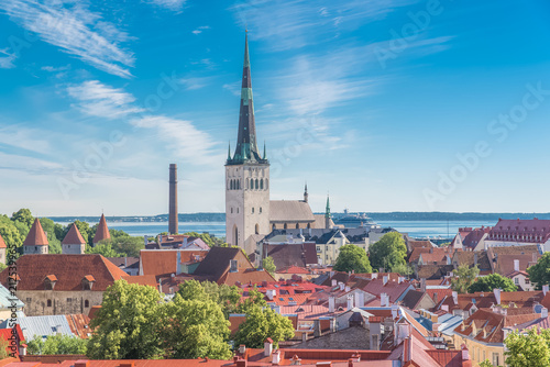 Tallinn in Estonia, panorama of the medieval city with St Olaf church and colorf Poster
