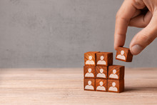 Building Team. The Leader Builds  Team From Cubes With Employees. Recruitment Concept. Copy Space