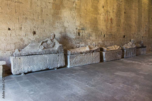 Fototapeta Tuscania, Viterbo, Italy: interior of San Pietro Church with sarcophagus