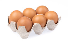 Eggs In Paper Tray Isolated On A White Background.