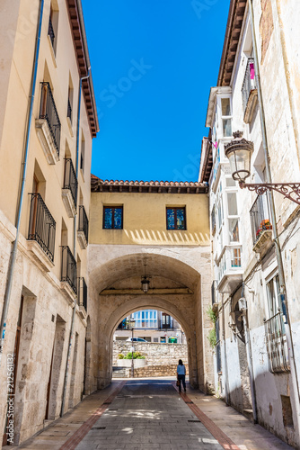 Street view of the Calle San Gil with the Arco de San Gil in Burgos, Spain