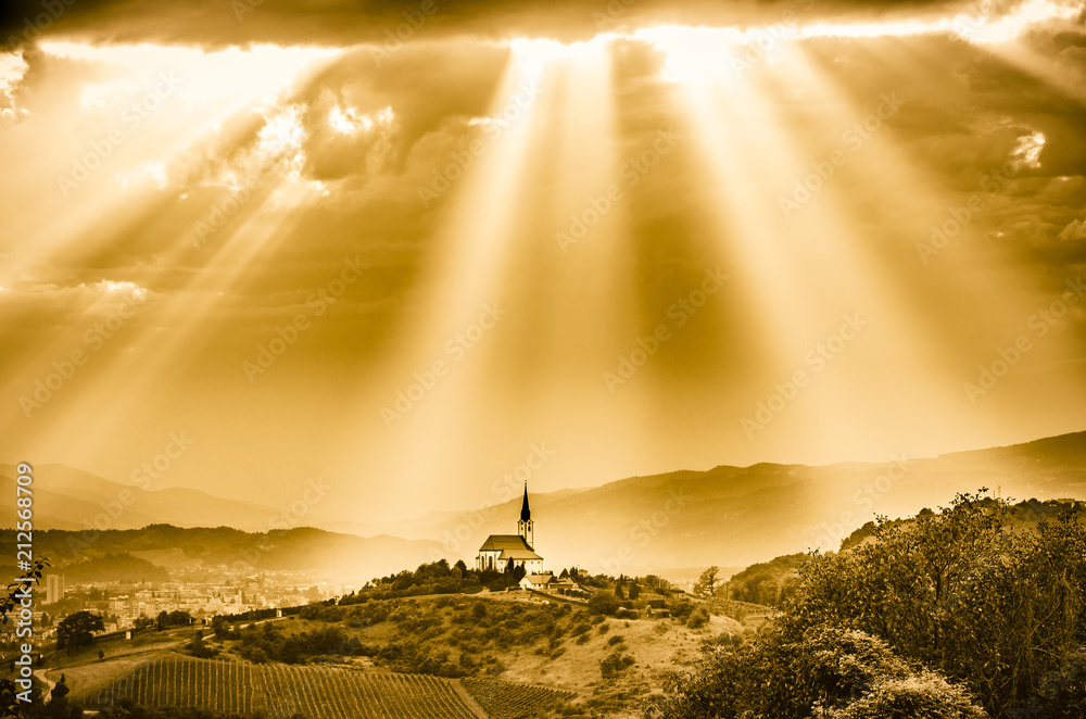 Fototapety, obrazy: Sun rays shining down on a Church. Sepia color.