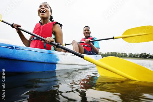 фотографія  Couple canoeing in a lake