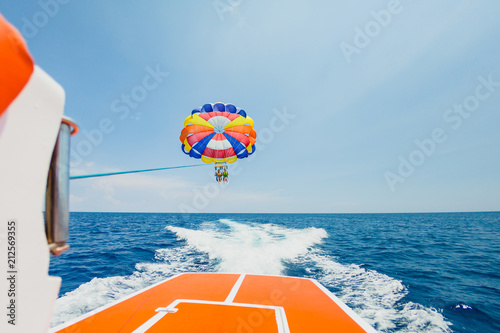 Recess Fitting Water Motor sports People flying on a colorful parachute towed by a motor boat