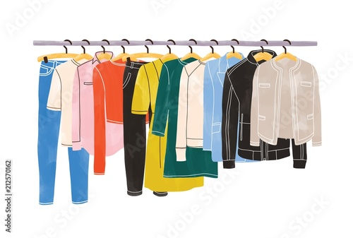 Fotografía  Colored clothes or apparel hanging on hangers on garment rack or rail isolated on white background