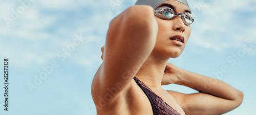 Fotografia Female swimmer in swim cap and googles