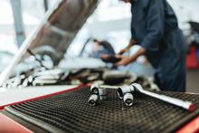 Ratchet Spanner And Sockets In Car Workshop