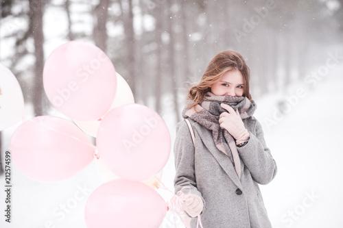Fotografie, Obraz  Winter portrait of girl holding pink balloons over snow background