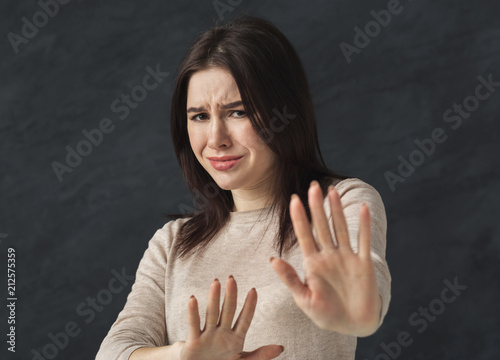 Woman showing stop sigh with her hand Fototapeta
