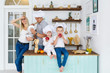 Happy family in white caps with two kids cooking at home food.