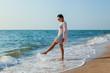 girl on the beach in a dress near the sea