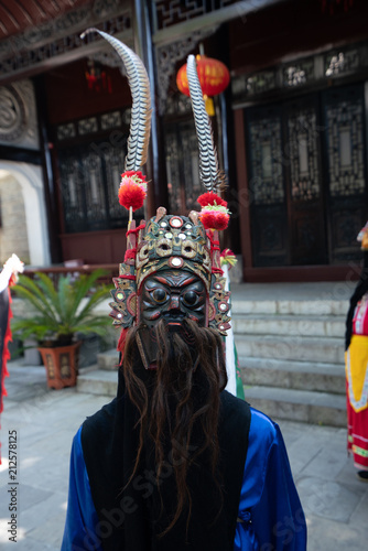 In de dag China Miao person wearing traditional mask