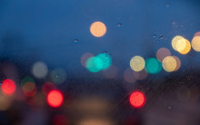 Blur Image Of Car Light At Night While It's Raining