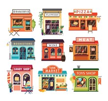 Collection Of Shop Buildings Isolated On White Background. Stores Selling Baked And Farm Products, Pizza, Flowers, Books, Wine, Meat, Candies, Toys. Colorful Vector Illustration In Cartoon Flat Style.