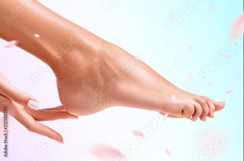 Woman touches her feet.